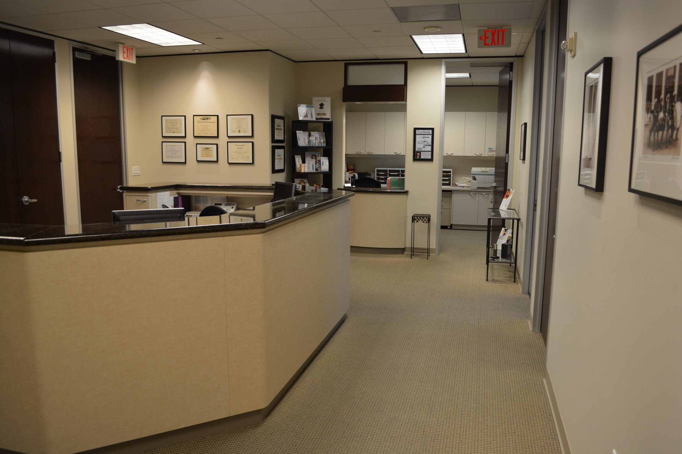 Office interior showing photographs, art and clinical workstation